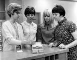 Gayle Richards, Carol Davis, Kara Waters, Eddie Tschopp in library, Georgia State College,...