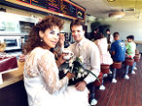 Newlyweds Florrie and Rick, at Dunkin Donuts drinking coffee after their wedding, Marietta,...