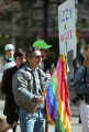 Demonstrator, Jon Ivan Weaver, with a gay pride flag at the Olympics-Out-of-Cobb protest, Woodruff...