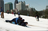 Sledders enjoying the snow in Piedmont Park during the 1993 blizzard, Atlanta, Georgia, March 1993.