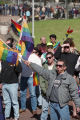 Demonstrator, Jon Ivan Weaver, waving a gay pride flag at the Olympics-Out-of-Cobb protest,...