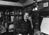Restaurant owner and railroad enthusiast, Dante Stephenson, inside the private coach where he...