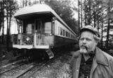 Restaurant owner and railroad enthusiast, Dante Stephenson, outside of the private coach where he...