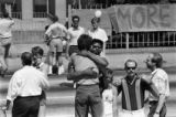 Demonstrators embrace at AIDS rally and vigil, Georgia State Capitol, Atlanta, Georgia, May 7,...
