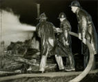 Firefighters use water hose to put out fire at Grady Memorial Hospital, Atlanta, Georgia. March...