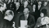 Martin Luther King, Jr. with his wife Coretta Scott King, being congratulated by Norway's King...