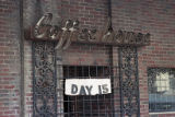 "Barred entrance to the Imperial Hotel with a sign that reads, ""Day 15,"" used in a..."