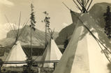 Tepee Camp on the shore of Lake McDermott, in Glacier National Park, before 1921.
