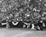 Atlanta Braves right fielder, Hank Aaron, hitting his record-breaking 715th career home run,...