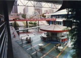 Food court at the Rio Shopping Center, looking west towards the Midtown skyscrapers, Atlanta,...