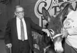 Manuel Maloof with donkey, outside Manuel's Tavern, part of Maloof's re-election campaign for CEO...
