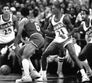 Julius Erving, Philadelphia 76ers, playing offense against Atlanta Hawks' Doc Rivers, Dominique...