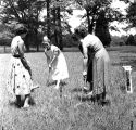 Student nurse, Patricia Welborn, playing croquet with patients at Milledgeville State Hospital,...