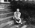 Flannery O'Connor sitting on the steps of her home in Milledgeville, Georgia, September 22, 1959.