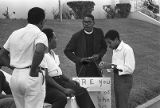 African American minister and picketers outside of the Atlanta Public Schools building, Atlanta,...