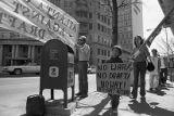 Atlanta Committee Against Registration and the Draft (ACAD) protesters in front of Jimmy Carter's...