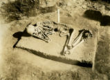 Skeleton in fetal position found at the Ocmulgee Indian ceremonial mound. Macon, Georgia, 1936.