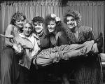 Music director Robert Ray being held by Emily Woodward, Lynn Fink, Kim Bowers, Stacia Fernandez,...