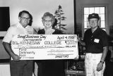 President of Kennesaw State University (then Kennesaw College) Betty Siegal accepting a $5,000...