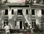 Margaret Mitchell's girlhood home being razed, Atlanta, Georgia, August 1952. Following Mitchell's...