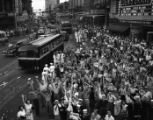 "Soldiers and others celebrate V-J Day (""Victory over Japan Day"") on Peachtree Street,..."