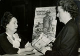 Margaret Mitchell buying a war-bond to support the U.S. World War II effort, Atlanta, Georgia,...