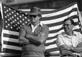 Men next to an American flag during Union Auto Workers protest against imported goods, Hapeville,...