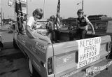 Children riding in a truck bed during a Union Auto Workers protest against imported goods,...