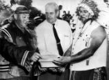 Yuchi Indians, Chief Samuel Wayne Brown, Sr. (left) and Rufus George (right) receive deed for 100...
