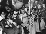 Taiwanese girls sing and chant in protest at the Govenor's mansion, Atlanta, Georgia, February 1,...