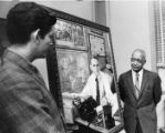 Artist donating a portrait of Ralph McGill to the Atlanta University Center, Atlanta, Georgia,...