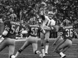 Dallas Cowboys' quarterback Danny White beating the Falcon's blitz during a play-off game,...