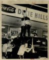 Police men climbing to the roof of a store during the Dixie Hills Riot, Atlanta, Georgia, June 20,...