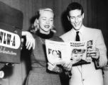 Merry Mutes host Dick Van Dyke reading a magazine with a blond woman, Atlanta, Georgia, early...