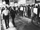 Striking city workers marching with police escorts, Atlanta, Georgia, April 1970.