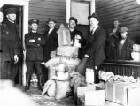Police pose with seized moonshine, Georgia, circa late 1930s or early 1940s.