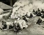 United States troops under a smoke screen in a mock attack, September 1942.