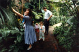 Family strolls though the Dorothy C. Fuqua Conservatory at the Atlanta Botanical Gardens, 1991
