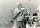 "AJC feature writer Charles Salter, with ""hybrid bass,"" Lake Hartwell, north Georgia,..."