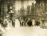 Bustling street scene of pedestrians and street cars in downtown Five Points, circa 1920s