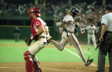 Atlanta Braves first baseman Fred McGriff scoring a run in Game 1 of National League Championship...