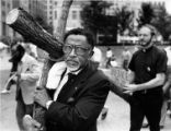 Reverand Joseph Lowery carries a cross during a march against the death penalty, 1987