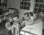 Group of girls practice reading and writing while staying at hospital, circa 1940s