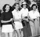 Female golfers pose for photos during golf tournament, 1949