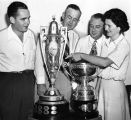 Louise Suggs with her British Amateur and U. S. Amateur cups, 1948