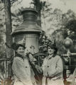 Thelma McPhail and Dulce Duckwortle pose in vintage fire fighter uniforms in front of steam fire...