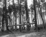 Navy frogmen training on a rope course, 1956
