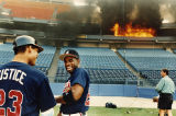 Atlanta Braves players Deion Sanders and Dave Justice watch the Fulton County Stadium press boxes...