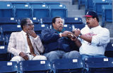 Braves fan Mark McEwen gets a baseball signed by Hank Aaron and Willie Stargell, 1991