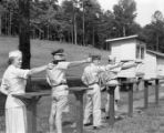 Major Katherine Sutherland competes as a sharpshooter for the Fort McPherson pistol team, 1958